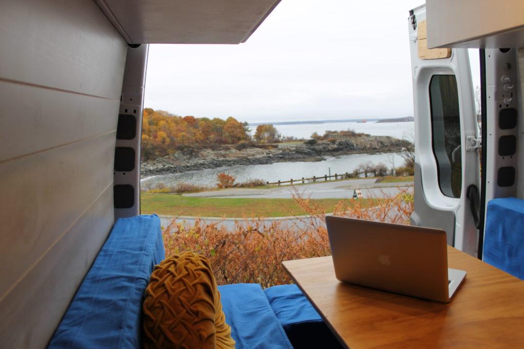 Conversion van with back door open to ocean view: Anxiety in van life