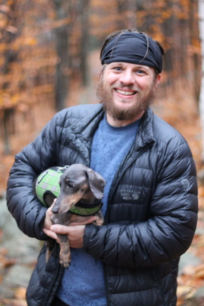 Man with dog in Acadia National Park: Anxiety in Van life