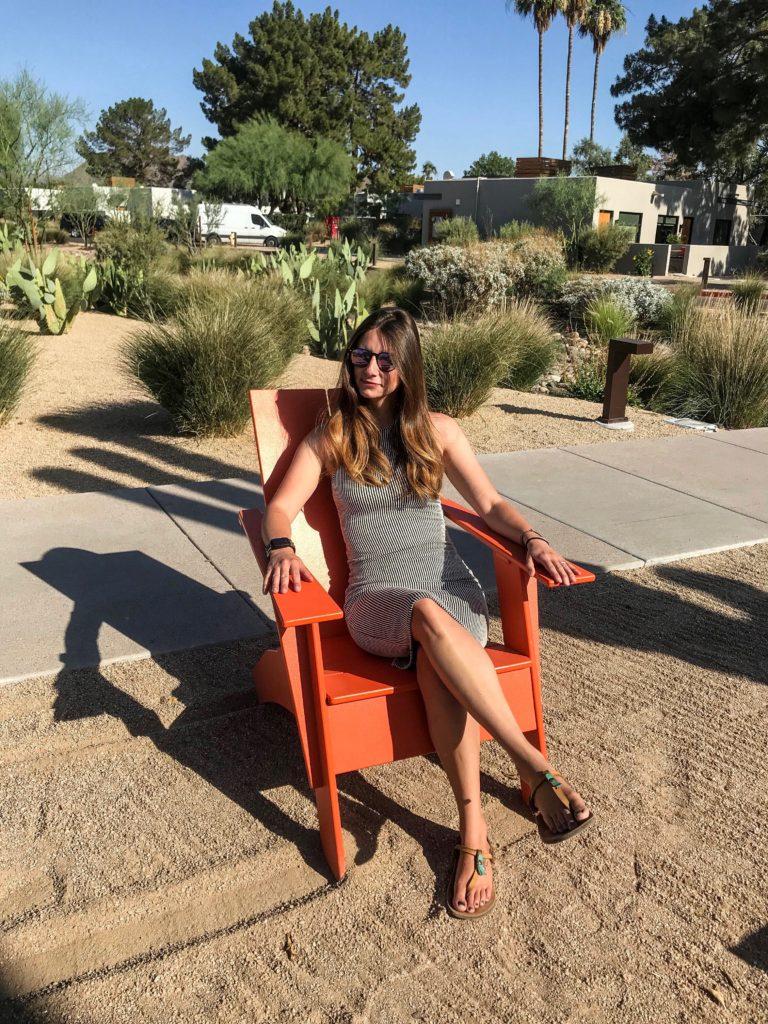 woman in orange chair: Van life guide to scottsdale